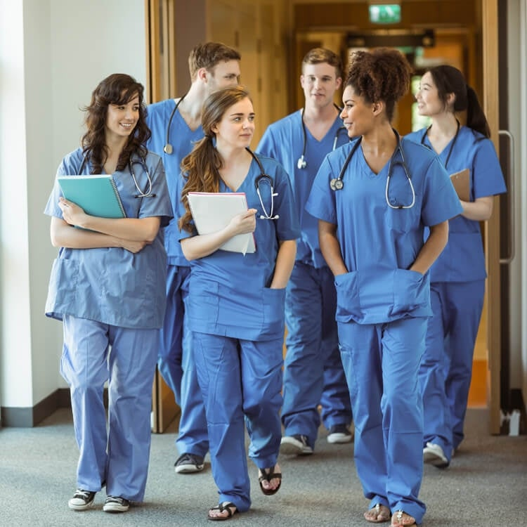 Group of nurses talking after class.